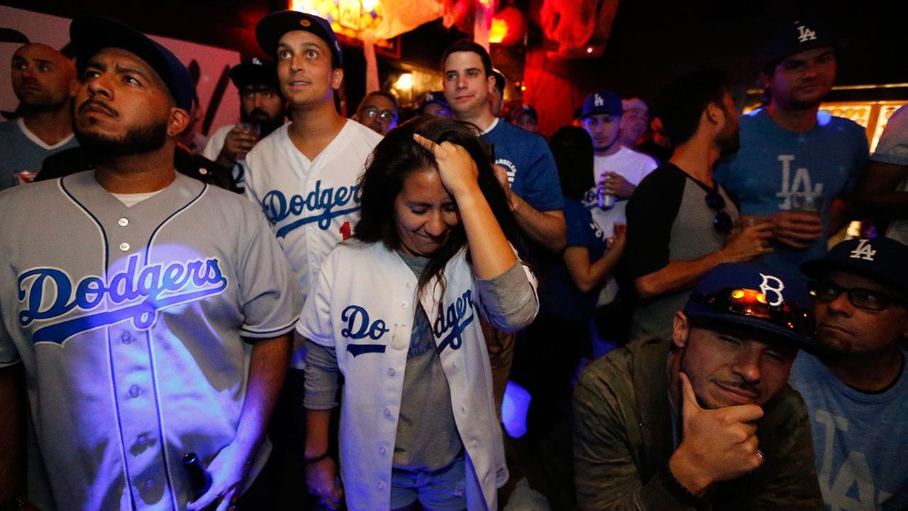Dodgers fans react as they watch the second inning of the World Series Game 7 at The Short Stop bar in Echo Park, Wednesday, Nov. 1, 2017.AP Photo/Damian Dovarganes