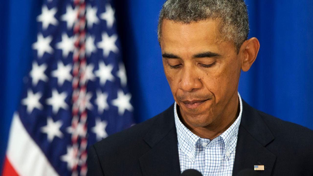 President Barack Obama pauses as he speaks about the situations in Iraq and in Ferguson, Mo., Thursday, Aug. 14, 2014, in Edgartown, Mass., during his family vacation on the island of Marthas Vineyard.