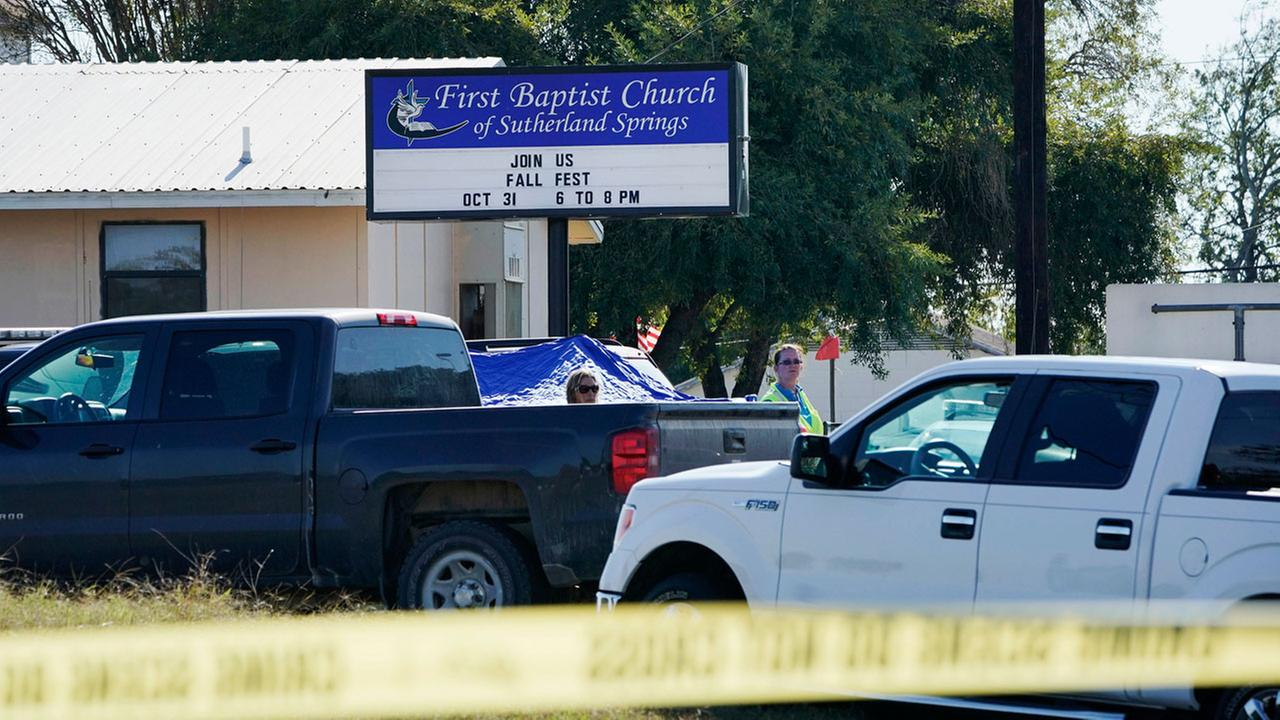 Law enforcement officers work in front of the First Baptist Church of Sutherland Springs after a fatal shooting, Sunday, Nov. 5, 2017, in Sutherland Springs, Texas.