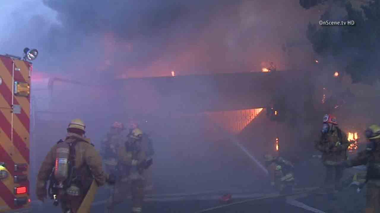 Los Angeles firefighters respond to the scene of a blaze at Hy-Grade Food Supply in the 7400 block of North Fulton Avenue in North Hollywood Friday, Aug. 15, 2014.