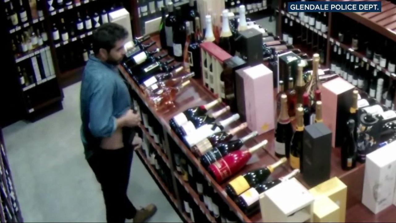 Surveillance video from a Mission Liquor Store in Glendale shows a man putting a wine bottle down his pants on Oct. 12, 2017.
