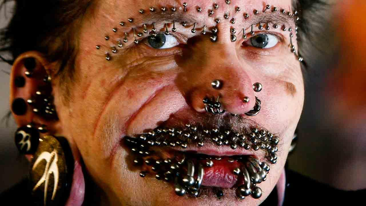 In this Saturday, Dec. 4, 2010 file photo, German Rolf Buchholz shows his face with 168 piercings as he visits the 20th Tattoo Convention in Berlin.
