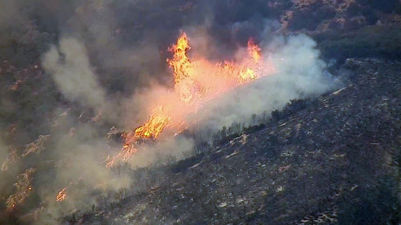 Large flames burn through the Angeles National Forest on Sunday, Aug. 17, 2014.
