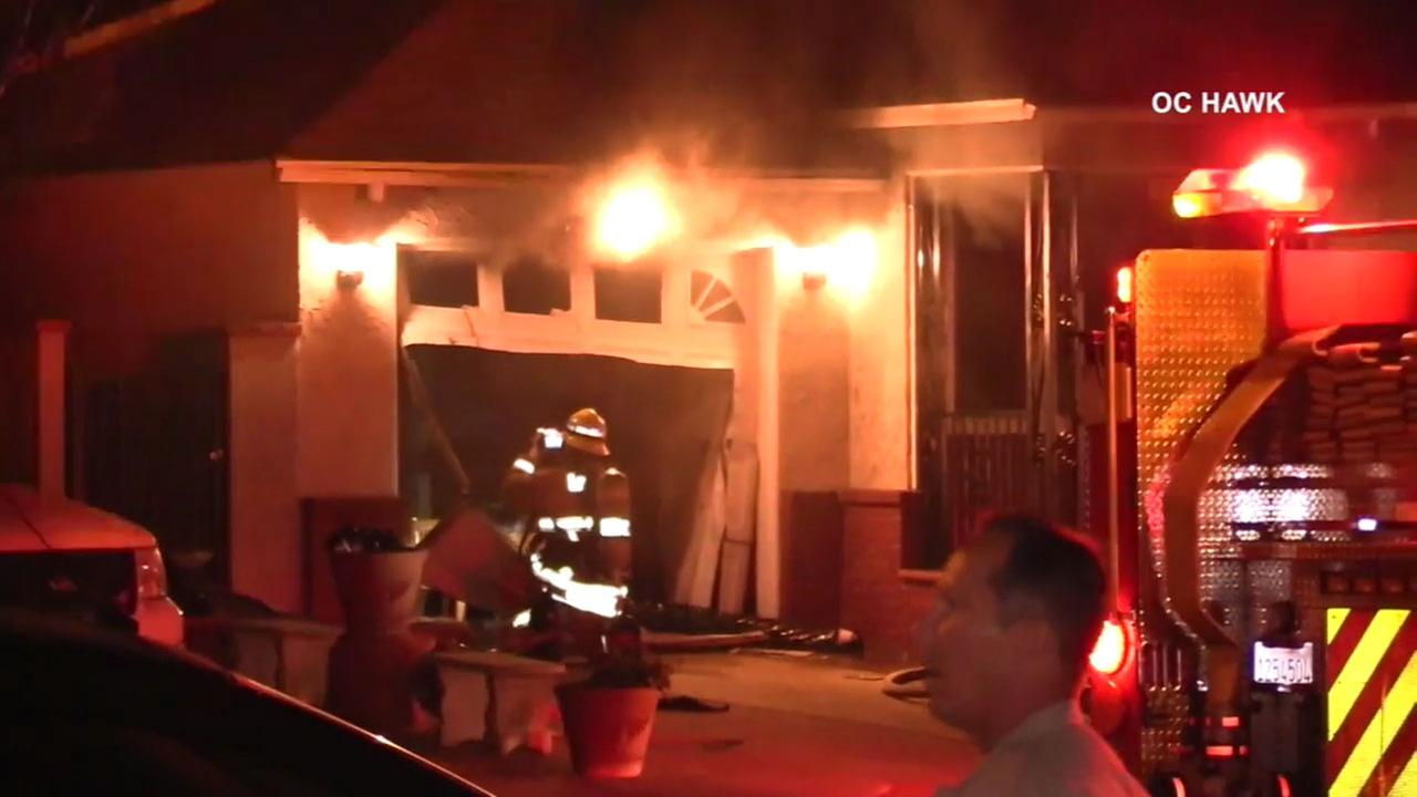 Firefighters battled a house fire after police said a teenager allegedly set fire to the residence when he got into an argument with his mother in Pico Rivera.