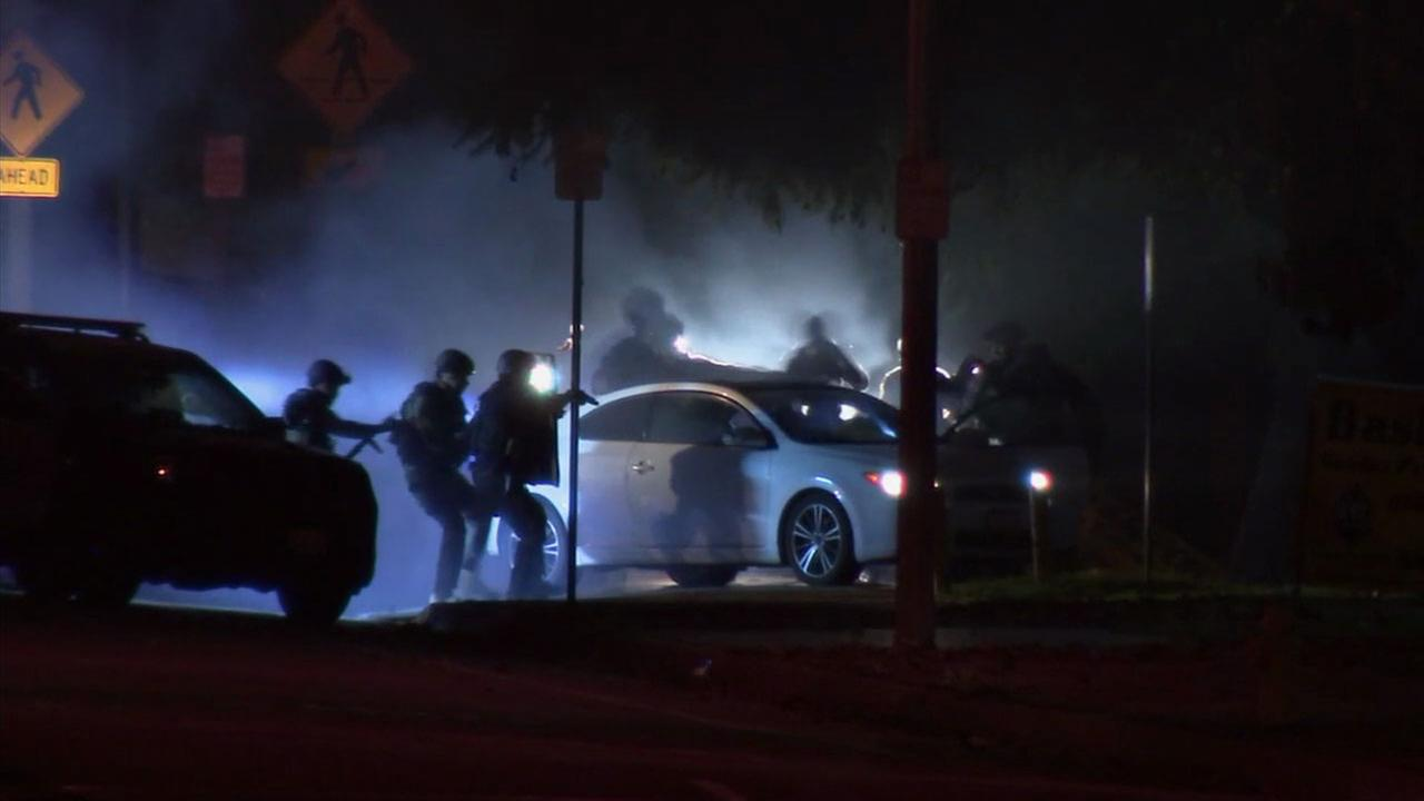Authorities threw a flash-band device and swarmed a vehicle after a tense, hourslong standoff with a father who allegedly held his infant daughter hostage in Covina.