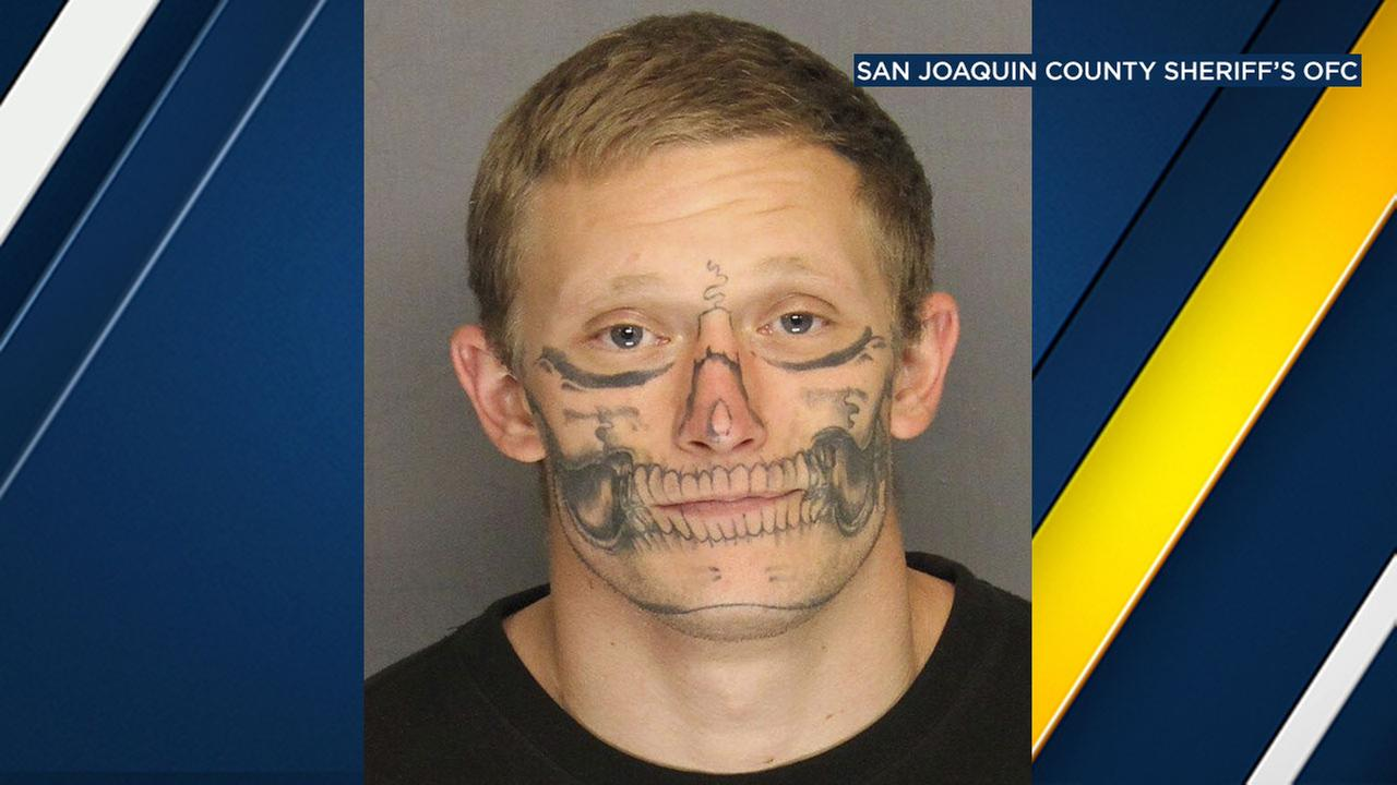 Officials search for missing inmate with skeleton face tattoo