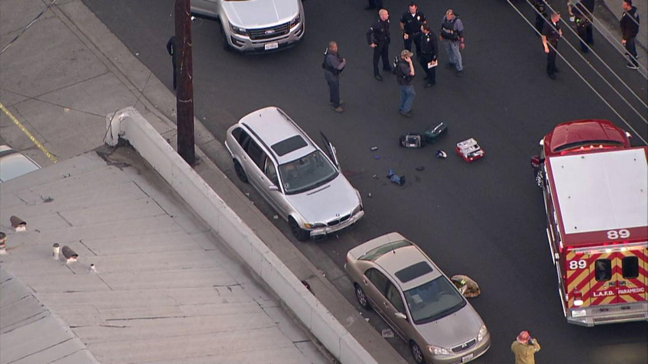 Officials investigate the scene in North Hollywood where a suspect was wounded in an officer-involved shooting after a short police chase.