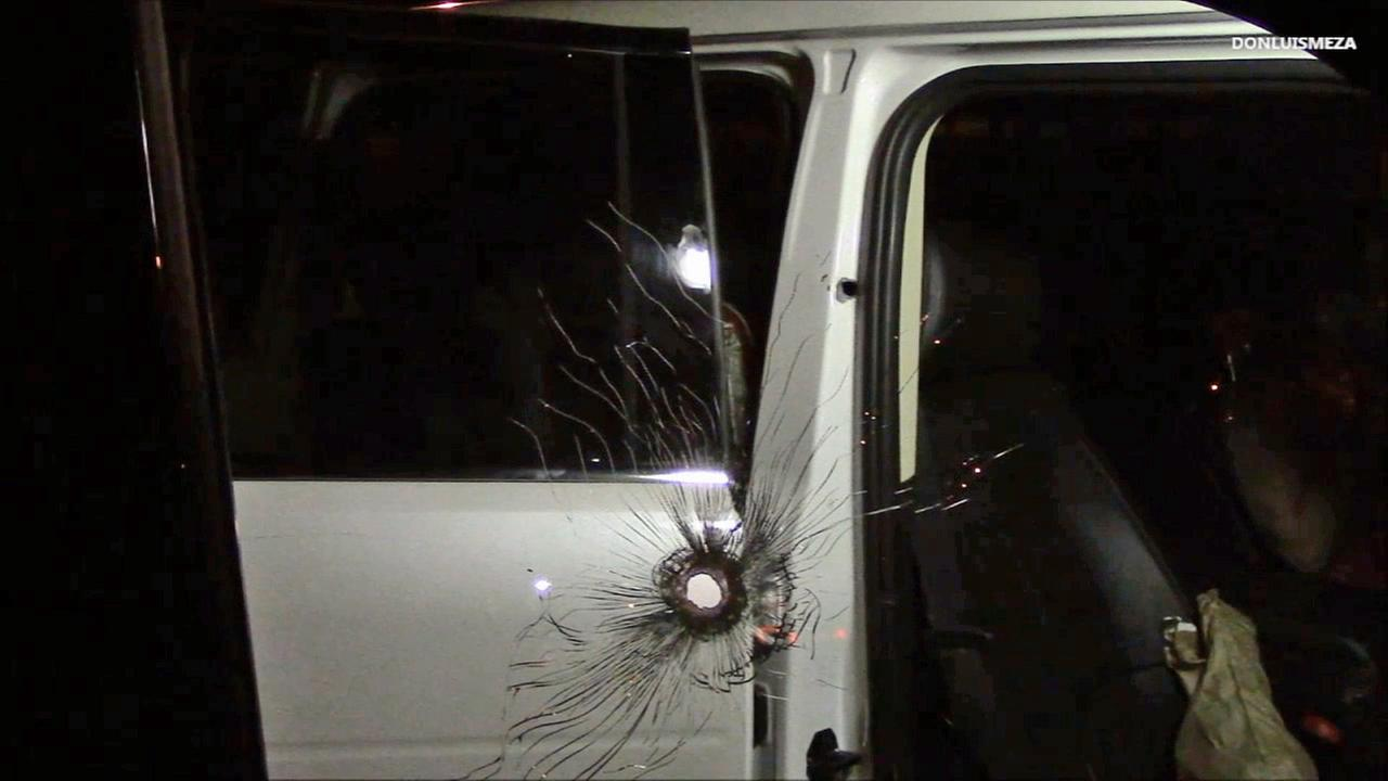 A bullet hole is seen in the car of a couple who was targeted by robbers in Lancaster on Thursday, Aug. 21, 2014.
