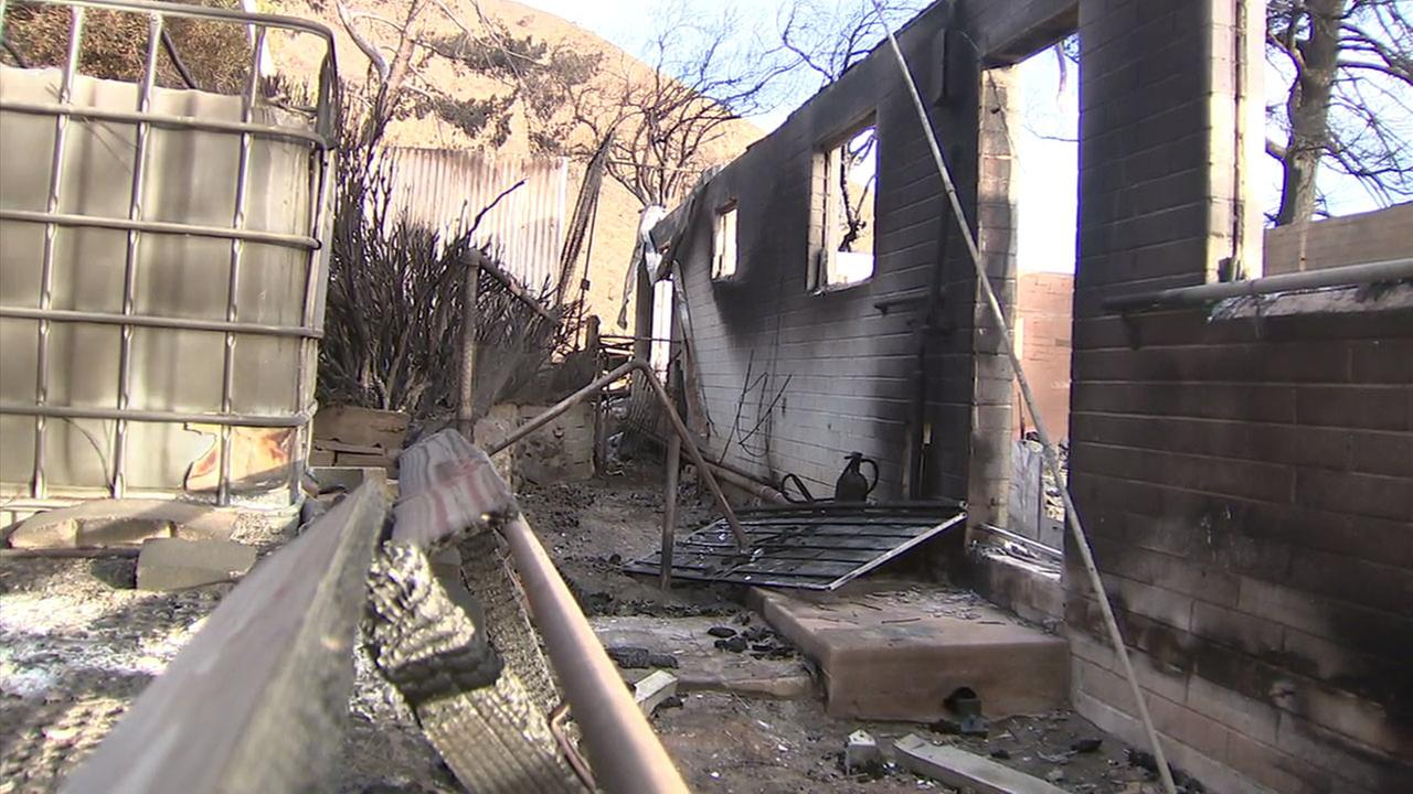A home destroyed by the Creek Fire is shown in a photo.