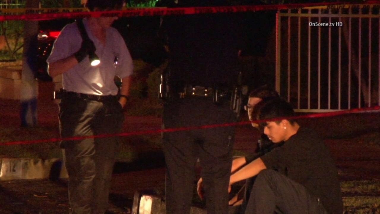 Police investigate a brawl that ended with a man being stabbing to death in Anaheim on Friday, Aug. 22, 2014.