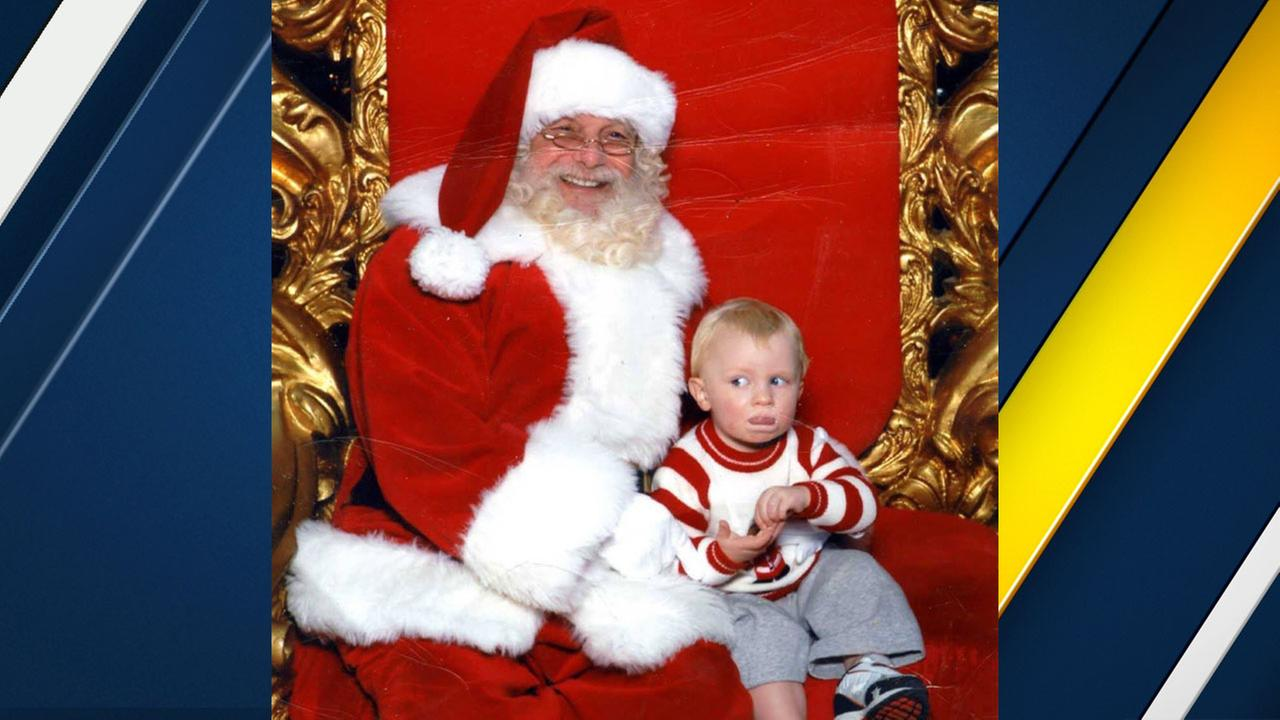 Baby Boy Signs for Help While Sitting with Santa