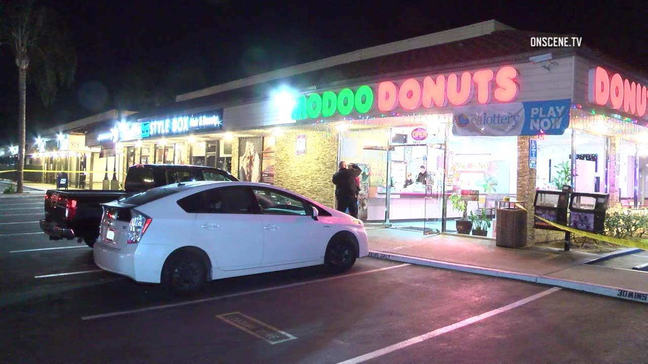 Crime scene tape ropes off a doughnut shop in Buena Park, where an employee was shot on Wednesday, Dec. 13, 2017.