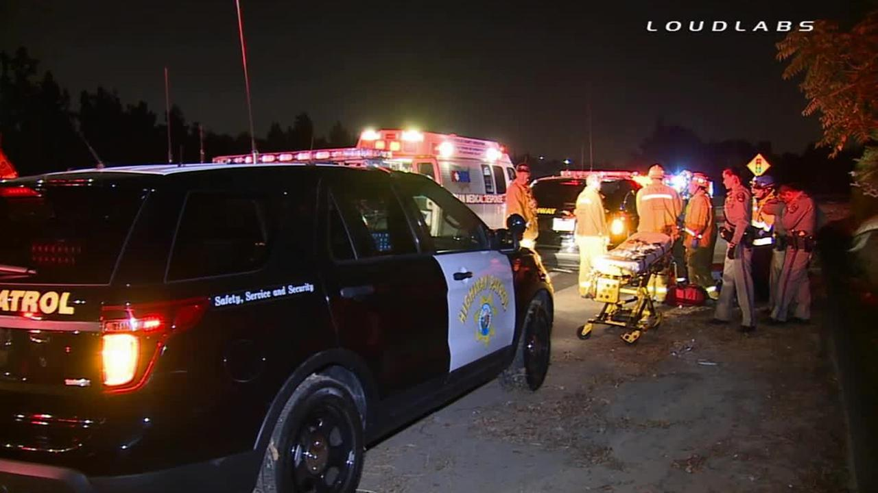 Firefighters and California Highway Patrol officers respond to a car-to-car shooting on the 60 Freeway in South El Monte, Saturday, Aug. 23, 2014.
