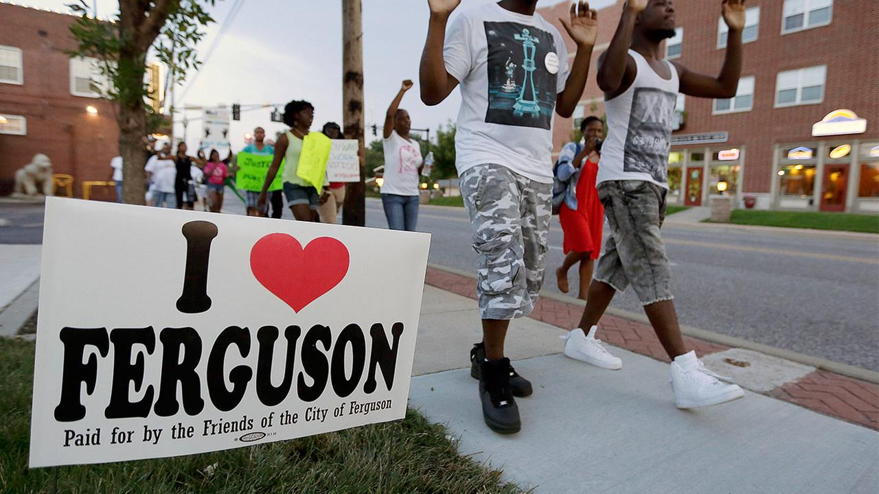 People march to protest the shooting of Michael Brown in Ferguson, Mo. on Aug. 20, 2014.