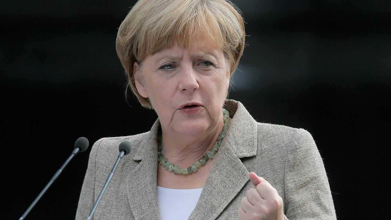 German chancellor Angela Merkel make a statement to the press in Kiev, Ukraine, Saturday, Aug. 23, 2014.