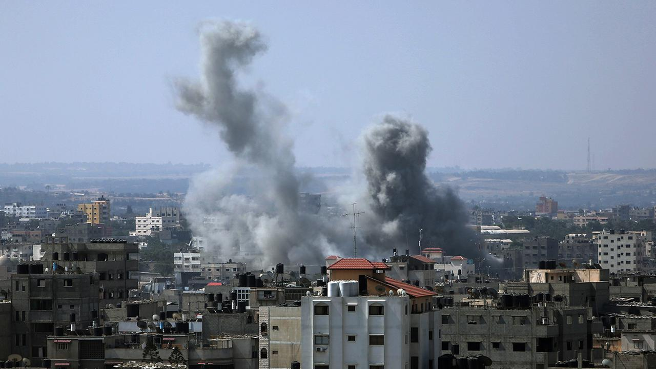 Smoke raises up in the sky following Israeli airstrikes in Gaza City, Saturday, Aug. 23, 2014.