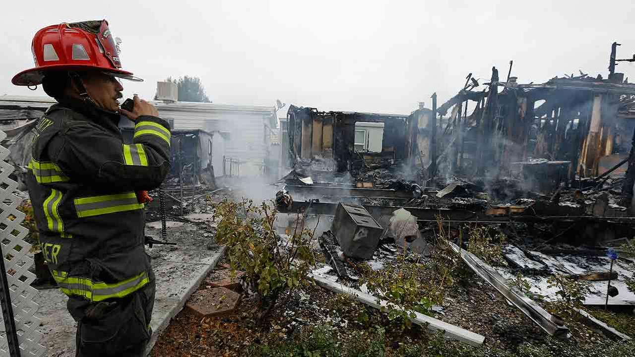 Napa Fire Captain Steve Becker inspects mobile homes which were destroyed Sunday, Aug. 24, 2014, at the Napa Valley Mobile Home Park, in Napa, Calif. Ben Margot