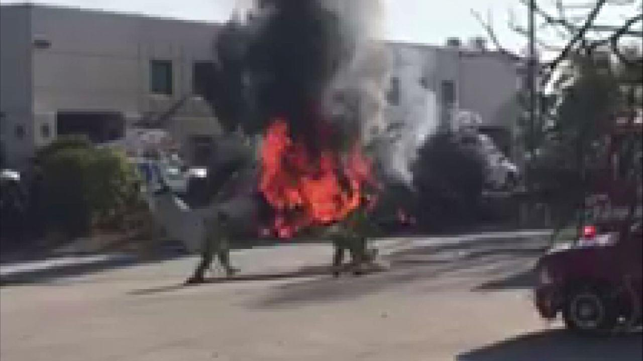 A fiery scene after a plane crashed in El Cajon on Sunday, Dec. 17, 2017, injuring two Huntington Beach police officers.