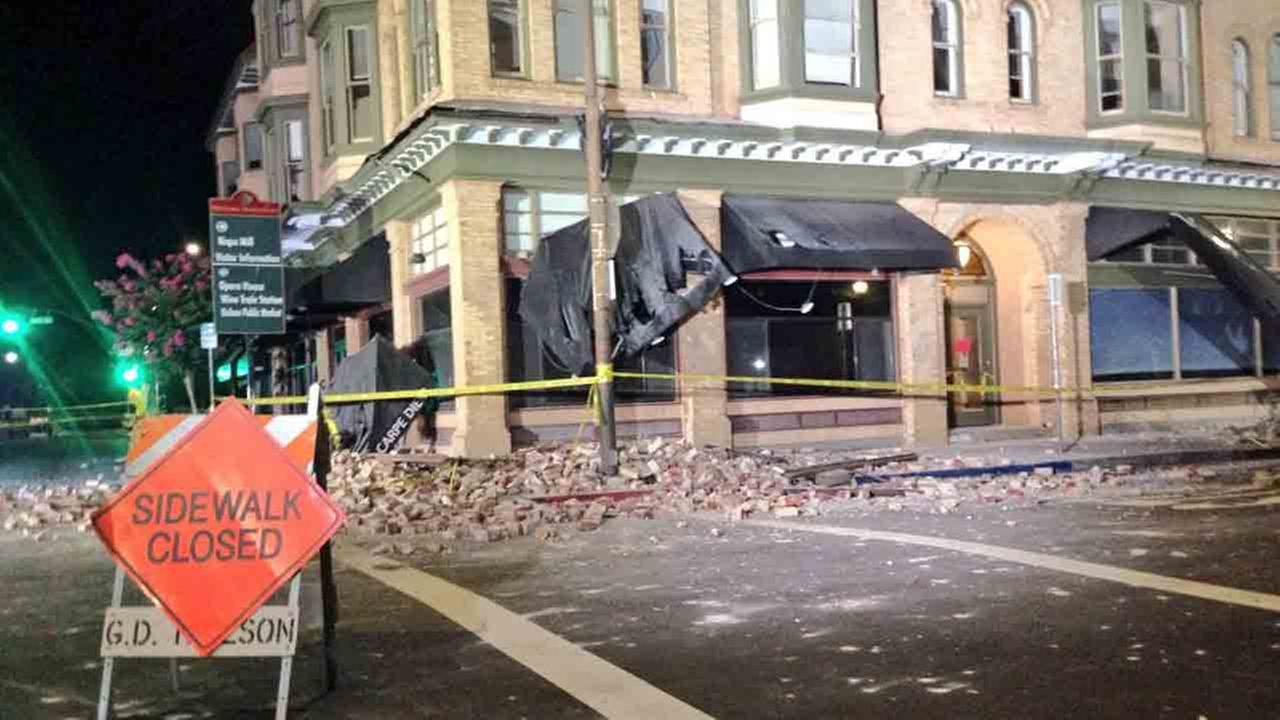 Bricks and debris surround the Alexandria Square building in Napa, Calif., following an earthquake Sunday, Aug. 24, 2014.