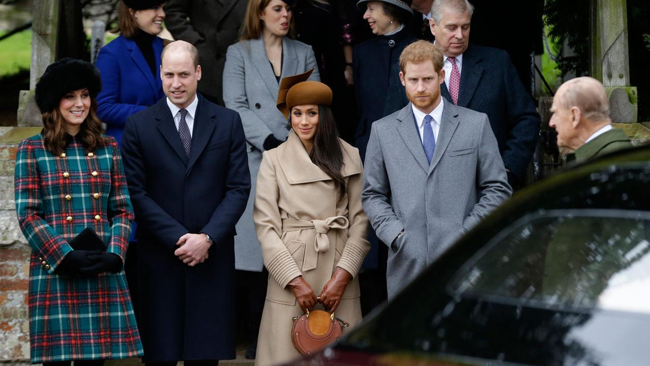 Kate, Duchess of Cambridge, left, with Prince William, Meghan Markle and Prince Harry wait as the Queen leaves by car following the traditional Christmas Day church service.