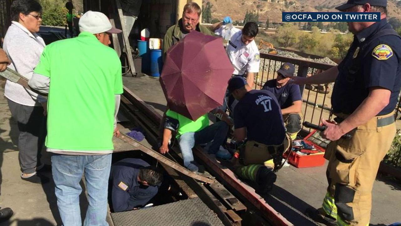 Orange County firefighters removed the guide rail from a Yorba Linda car wash to free a worker whose foot was caught in the mechanism.