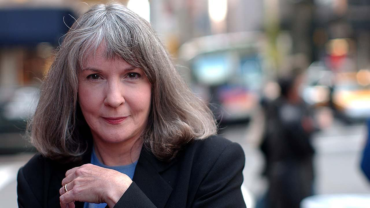 Mystery writer Sue Grafton poses for a portrait during a visit to New York Oct. 15, 2002. AP Photo/Gino Domenico
