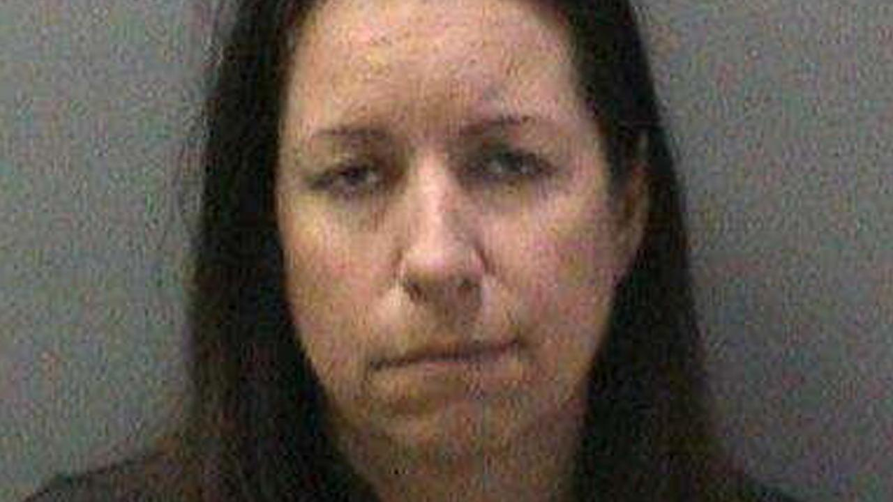 Kelly Michelle Wolfe, 46, is seen in this booking photo from the Orange County Sheriffs Department.
