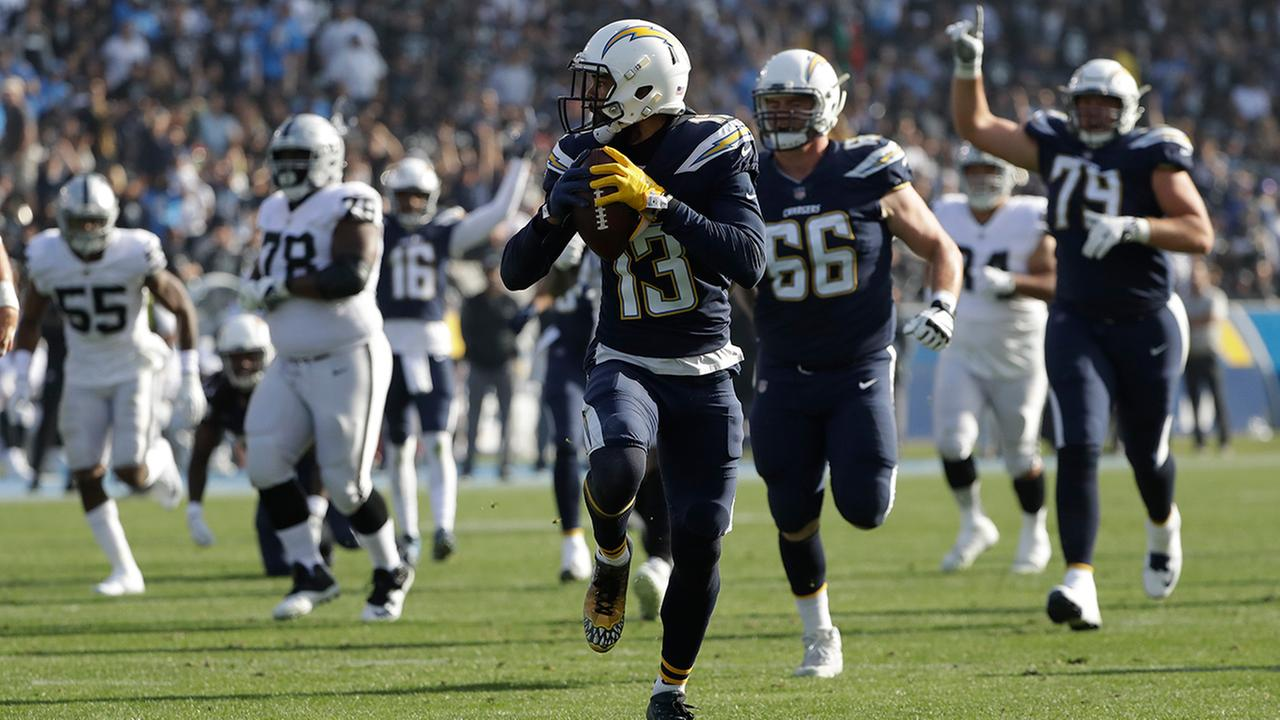 Chargers wide receiver Keenan Allen, center, runs for a touchdown during the first half of a game against the Raiders, Sunday, Dec. 31, 2017, in Carson.