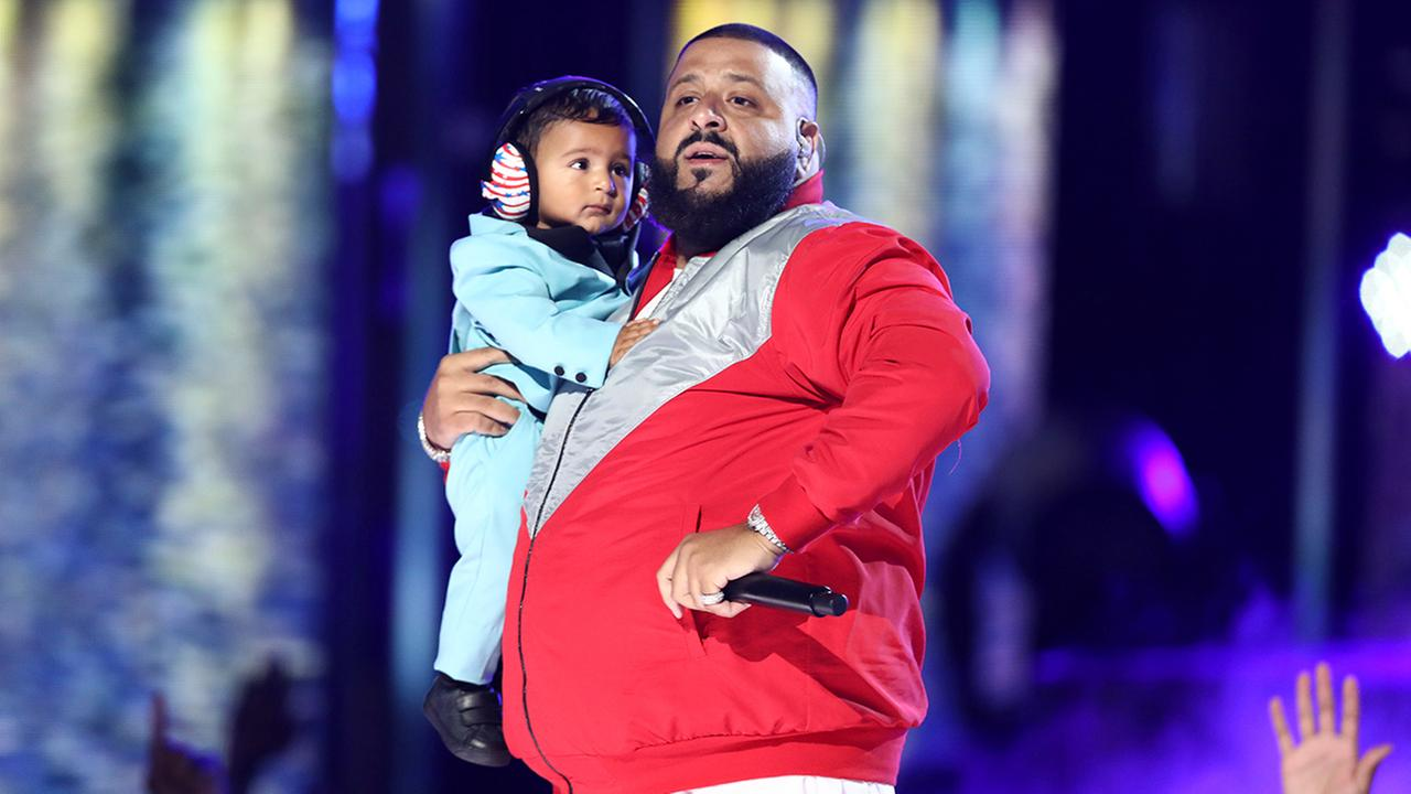 DJ Khaled performs Im The One while holding his son Asahd at the BET Awards at the Microsoft Theater on Sunday, June 25, 2017, in Los Angeles.
