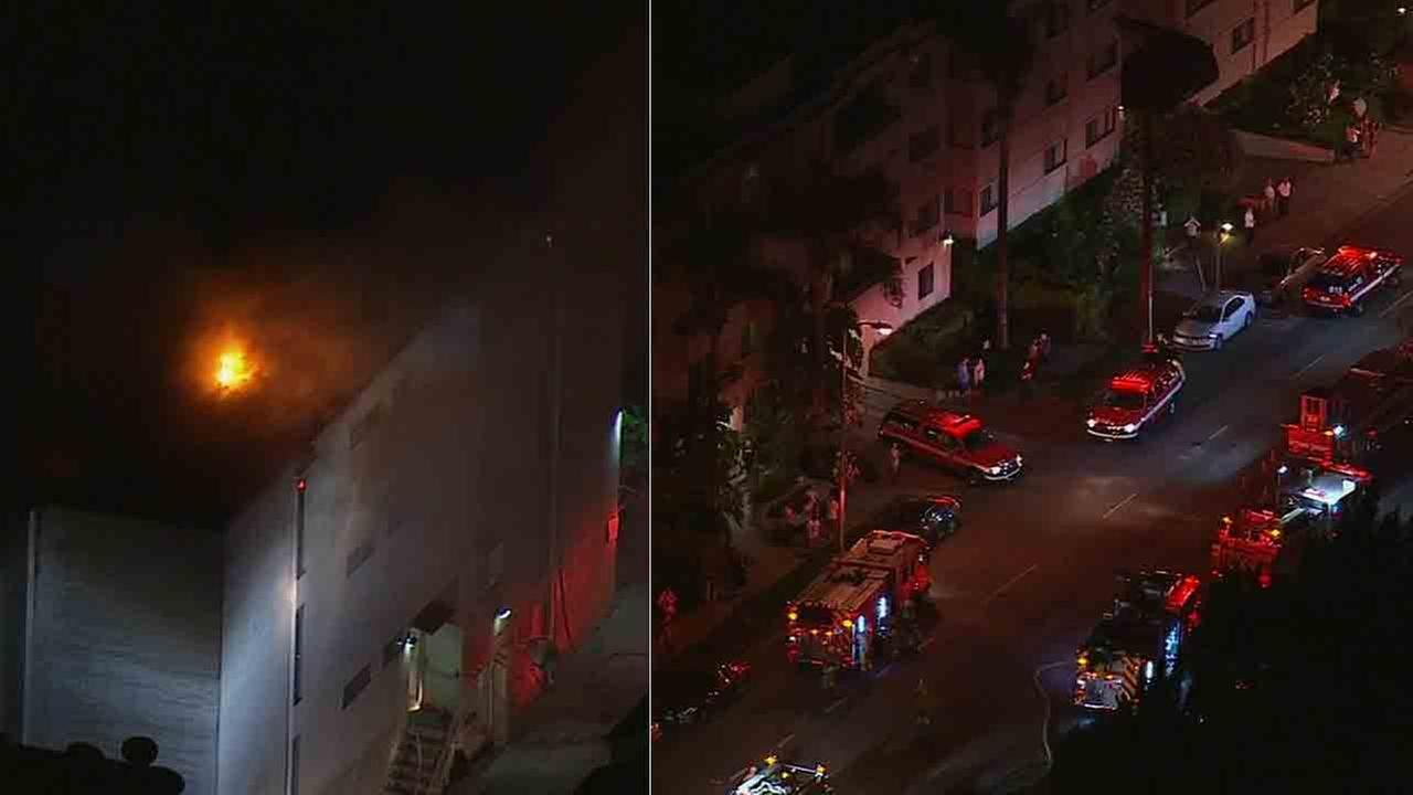 Los Angeles Fire Department officials respond to the scene of a three-story apartment building fire in the 5300 block of Newcastle Avenue in Encino Thursday, Aug. 28, 2014.