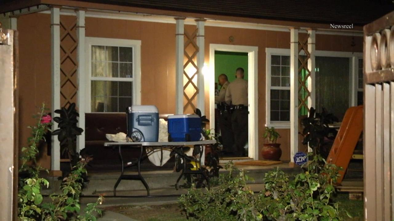 Sheriffs deputies investigate a home invasion on Thursday, Aug. 29, 2014.
