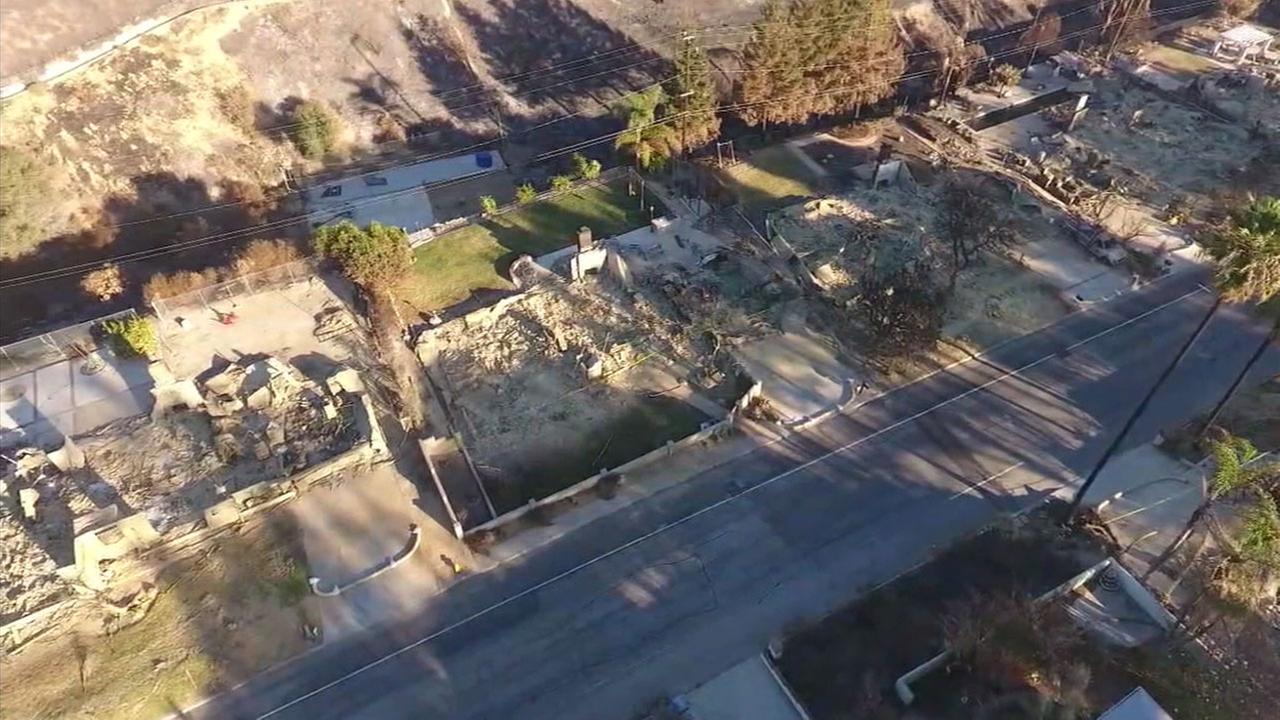 The rubble and leftover pieces of a homes destroyed in the Thomas Fire are shown in a drone photo along streets in Ventura.