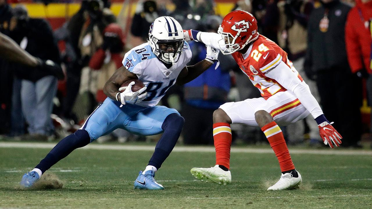 Titans wide receiver Corey Davis is tackled by Chiefs defensive back Will Redmond during the second half of an NFL wild-card game, in Kansas City, Mo., Saturday, Jan. 6, 2018.
