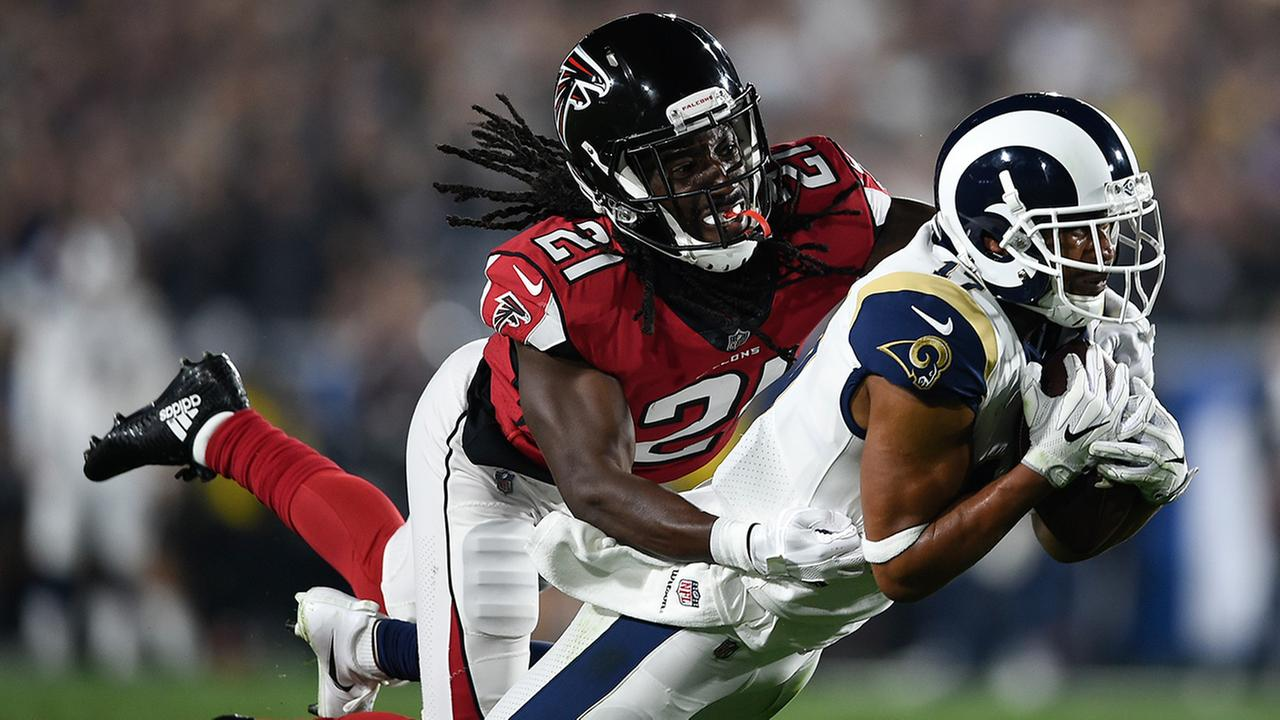 Rams wide receiver Robert Woods catches a pass in front of Falcons cornerback Desmond Trufant during a wild-card playoff game Saturday, Jan. 6, 2018, in Los Angeles.