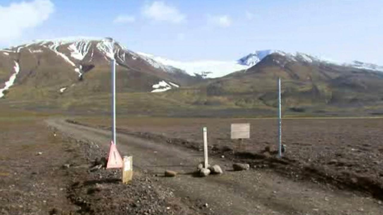 This is a Aug. 19, 2014 file image taken from video of a sign is posted on the road next to Bardarbunga, a subglacial stratovolcano located under Icelands largest glacier.