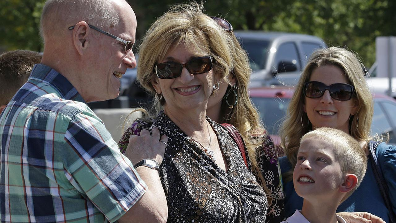 Jan Harding, center, is surrounded by family members as she speaks with reporters in Salt Lake City on Friday, Aug. 29, 2014.