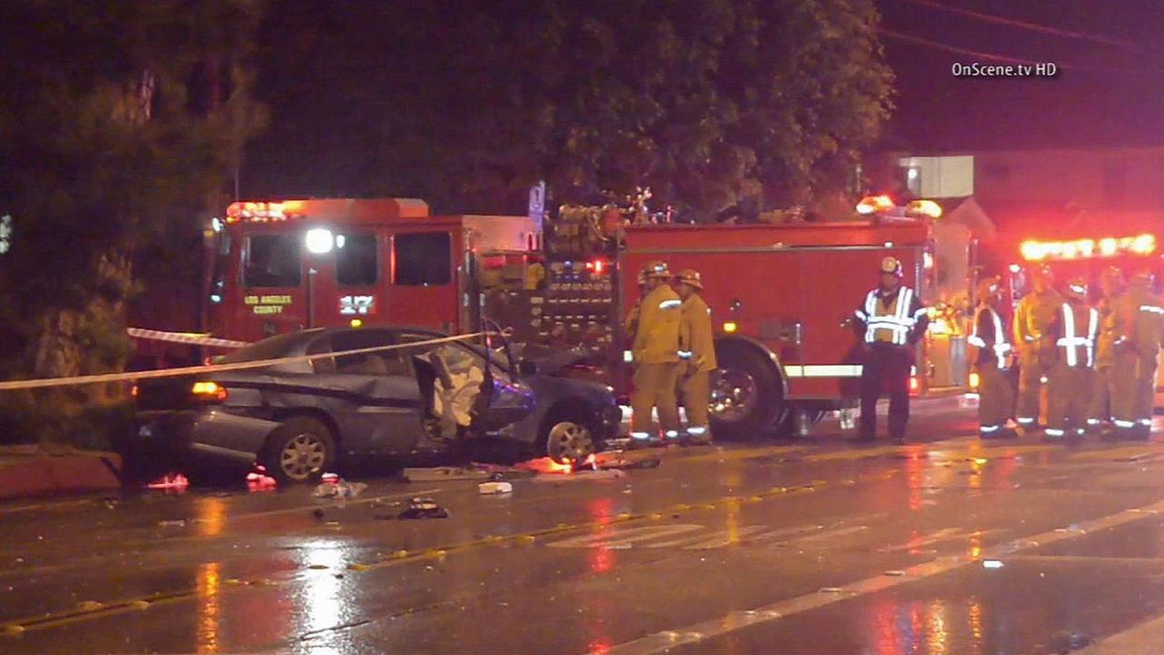 The scene of a car crash that left a young woman dead and two other people injured in Whittier on Saturday, Aug. 30, 2014.