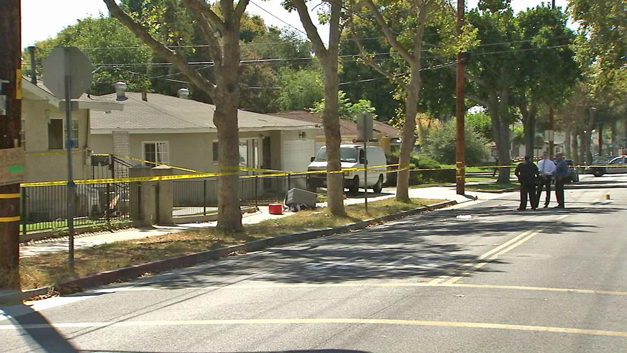 Authorities investigate a shooting in the 8000 block of Washington Avenue in Whittier on Saturday, Aug. 30, 2014.
