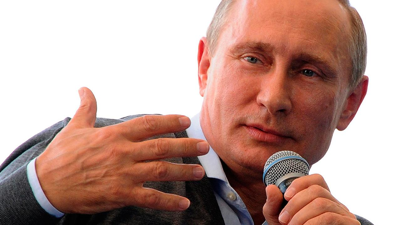 Russian President Vladimir Putin gestures while speaking during his meeting with the youth educational forum at the Seliger youth camp near Lake Seliger, Friday, Aug. 29, 2014.