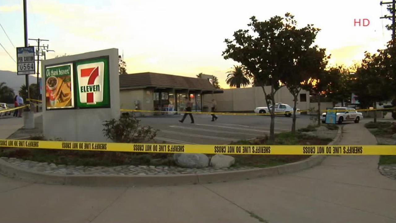 Authorities tape off a 7-Eleven where a clerk was stabbed on Sunday, Aug. 31, 2014.