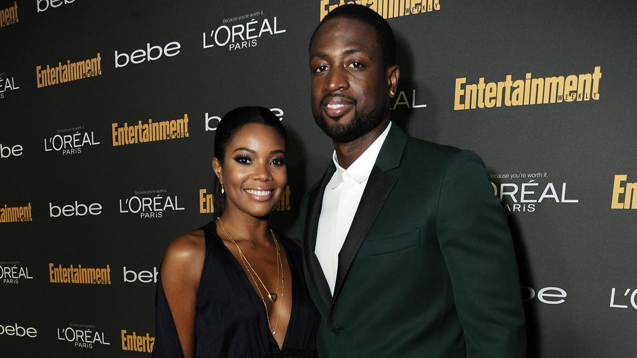Gabrielle Union and Dwyane Wade arrive at the 2013 Entertainment Weekly Pre-Emmy Party at Fig and Olive on Friday, Sept. 20, 2013, in Los Angeles.