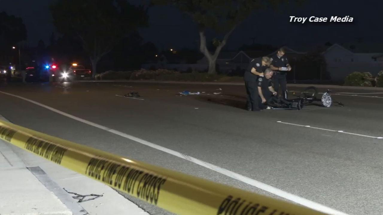 Huntington Beach police respond to the area near Bolsa Chica Road and Heil Avenue where a male bicyclist was fatally struck Monday, Sept. 1, 2014.