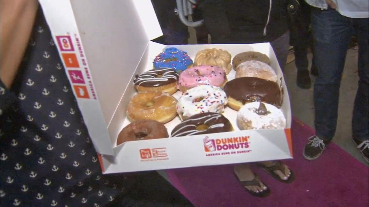 A box of Dunkin Donuts is seen at the grand opening of the Santa Monica store on Tuesday, Aug. 2, 2014.