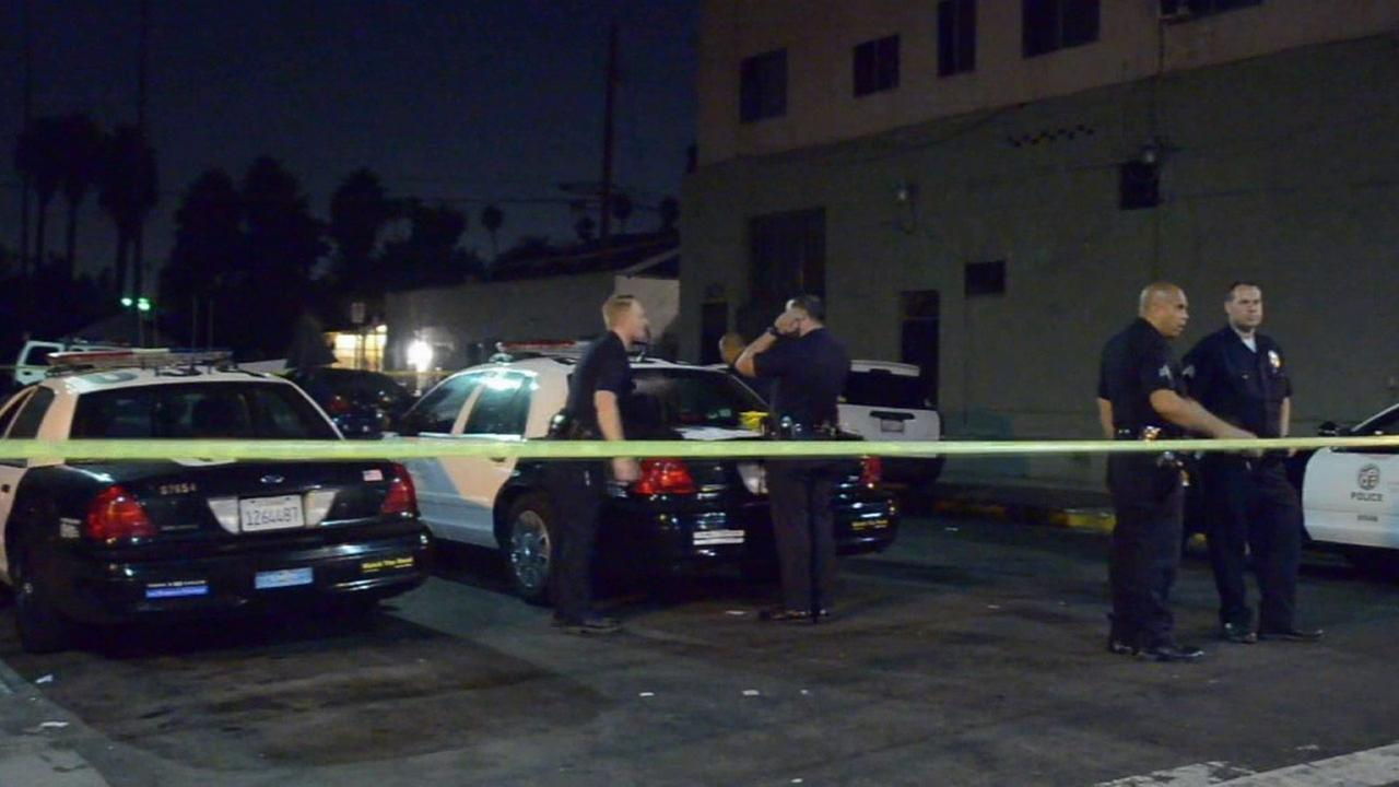 The LAPD investigates a shooting in South Los Angeles Monday, Sept. 1, 2014.