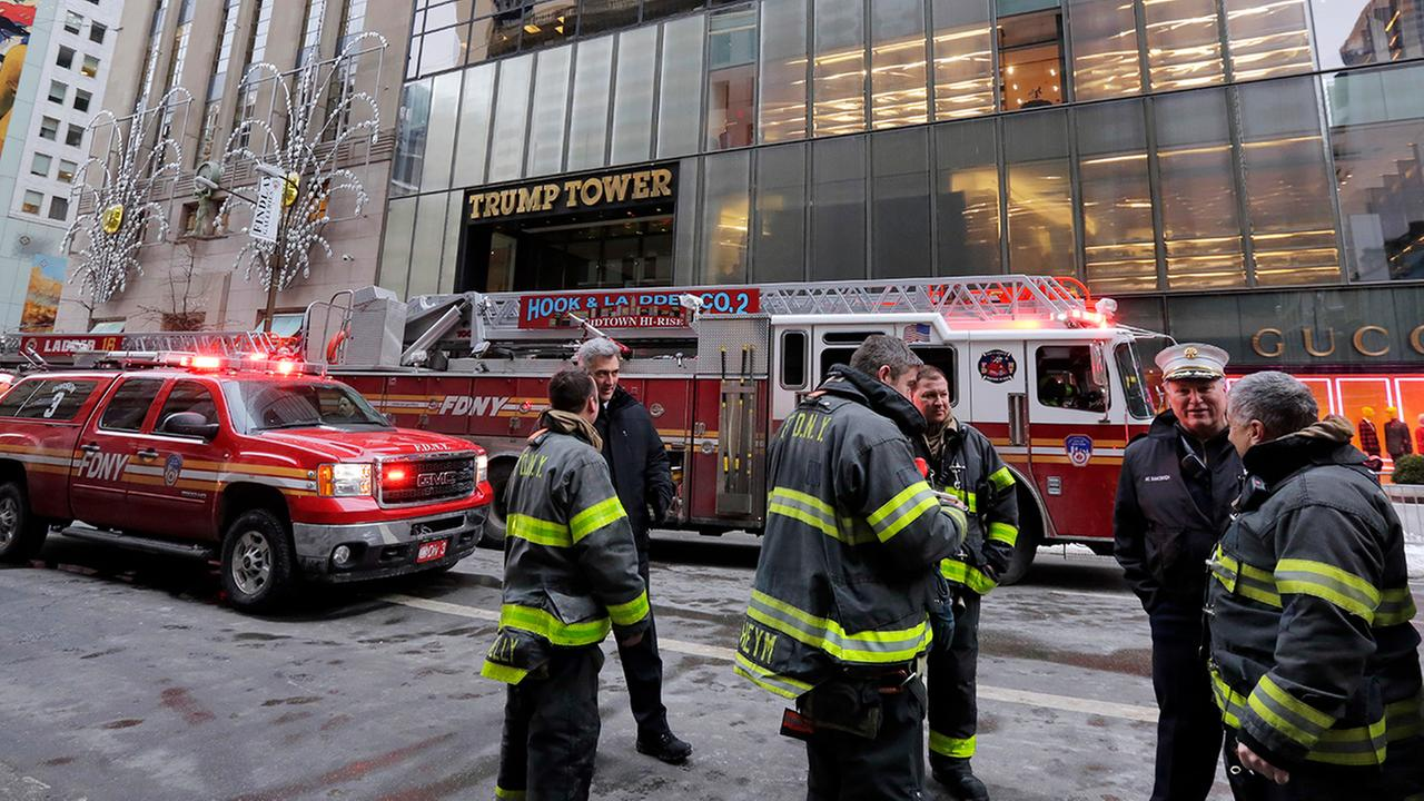 New York City Fire Deptartment vehicles sit on Fifth Avenue in front of Trump Tower, in New York, Monday, Jan. 8, 2018.
