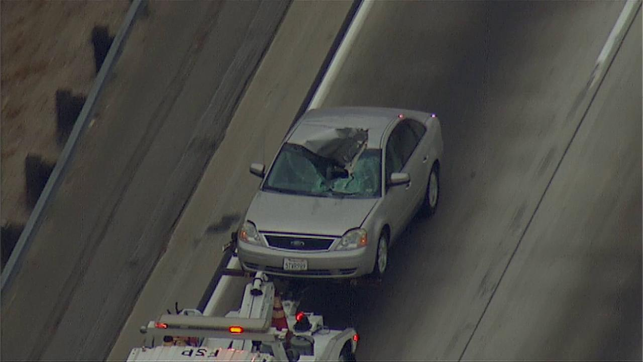 A tire hit a Los Angeles school police officers car on the 110 Freeway Wednesday, Sept. 3, 2014.