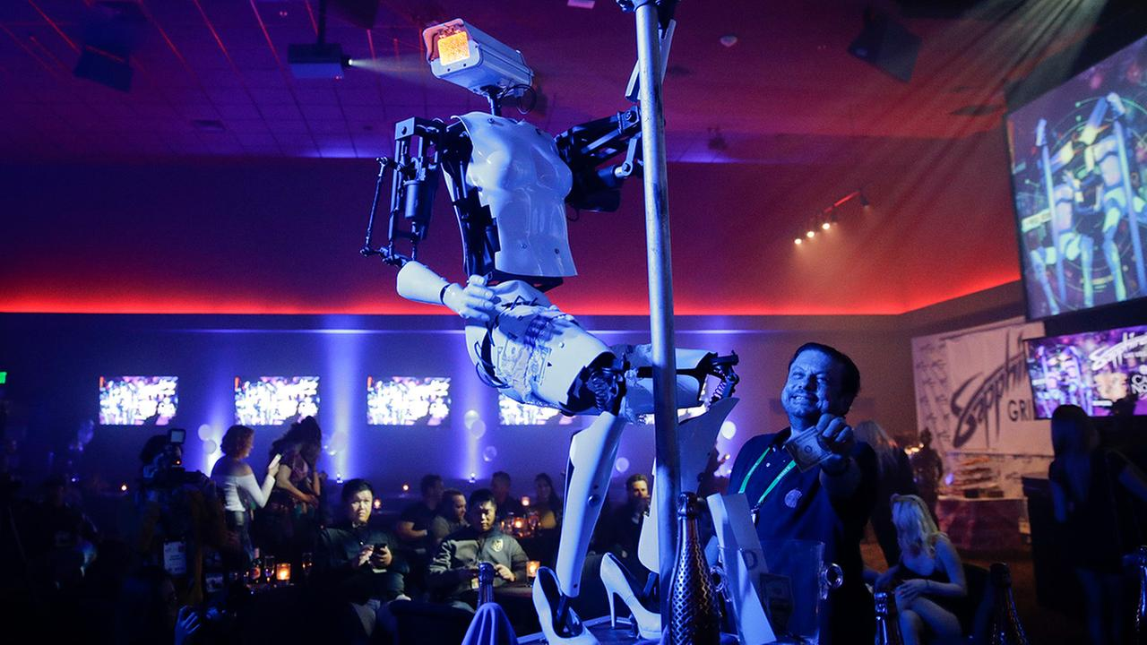 A pole-dancing robot built by British artist Giles Walker performs at a gentlemens club Monday, Jan. 8, 2018, in Las Vegas. The event was held to coincide with CES International.