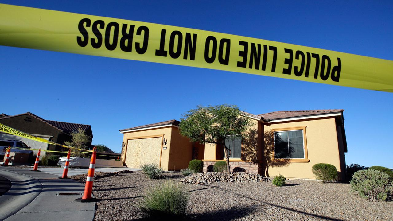 This Oct. 2, 2017 file photo shows police tape blocking off the home of Stephen Craig Paddock in Mesquite, Nev.
