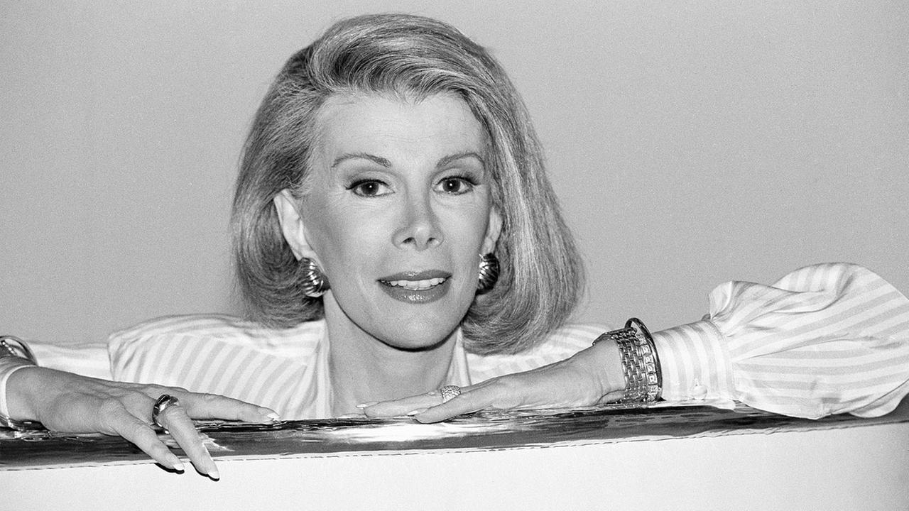 In this Aug. 15, 1989 file photo ,Joan Rivers announces that she is starting a new syndicated talk show, The Joan Rivers Show, in Los Angeles.
