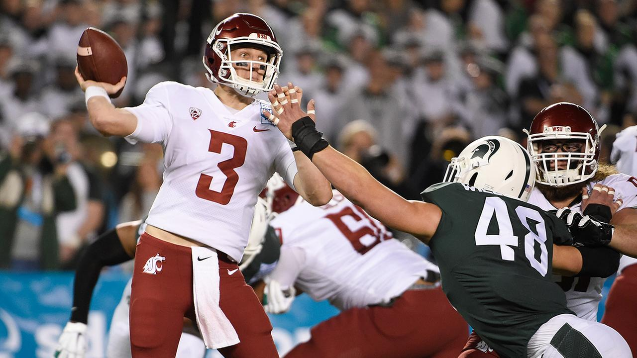 Washington State quarterback Tyler Hilinski throws under pressure during the first half of the Holiday Bowl NCAA college football game Thursday, Dec. 28, 2017, in San Diego.